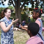 UD Study Abroad students interact with children in Barbados