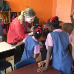 UD study abroad student in the classroom with children.