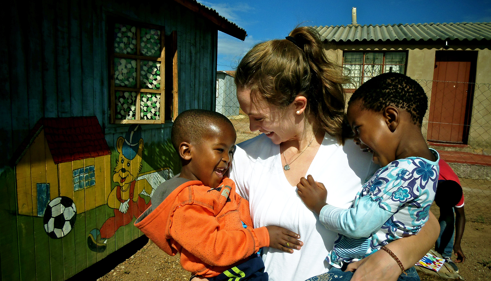 Student teacher with children at South African daycare