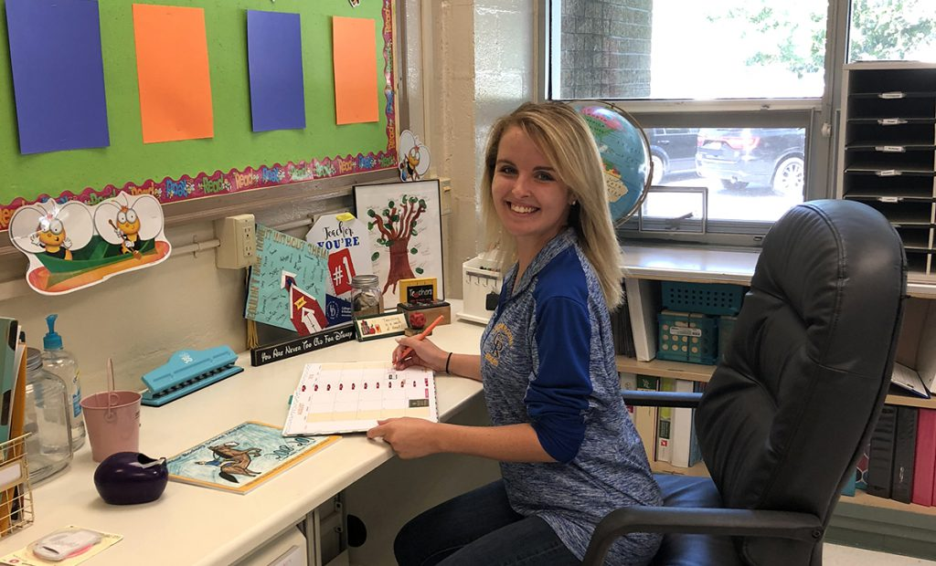 Emily Halliday sits in her classroom