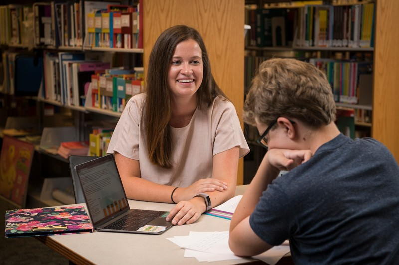 Cristina Ahrendt works with a student in the Education Resource Center
