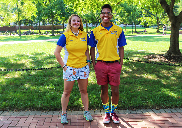 Katie Manta and Josh Lewis smile on the UD campus