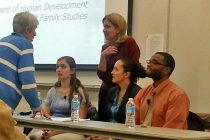 UD students (from left) Lauren Stegman, Lara Andrews and Kendall Daughtry join faculty member Bahira Sherif Trask (standing, center) for a panel discussion at the Osher Lifelong Learning Institute in Wilmington.