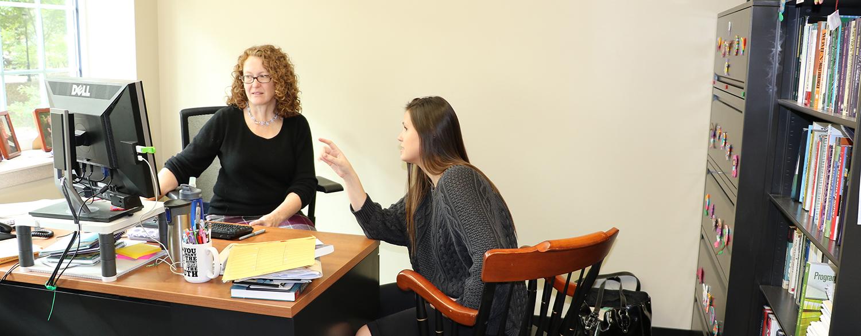Fleury Blythe talking to student