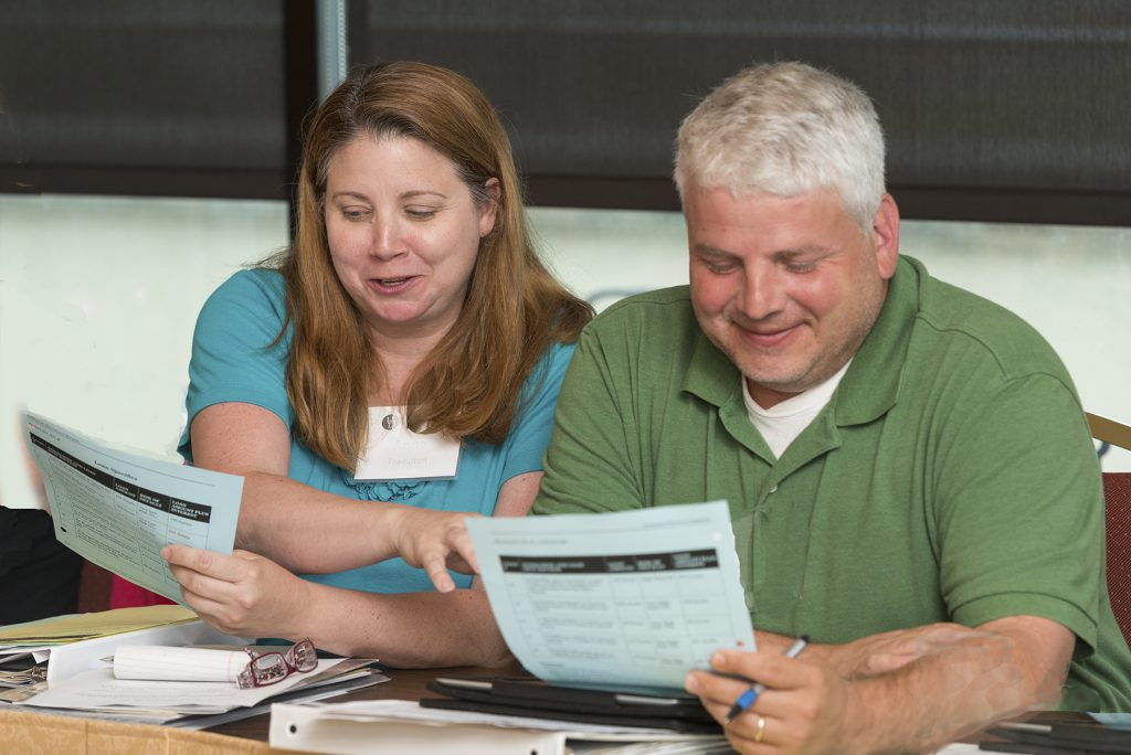 Two educators attend a training session