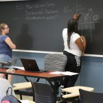 Students discuss math problem