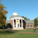 Students walk past Memorial Hall on the UD campus