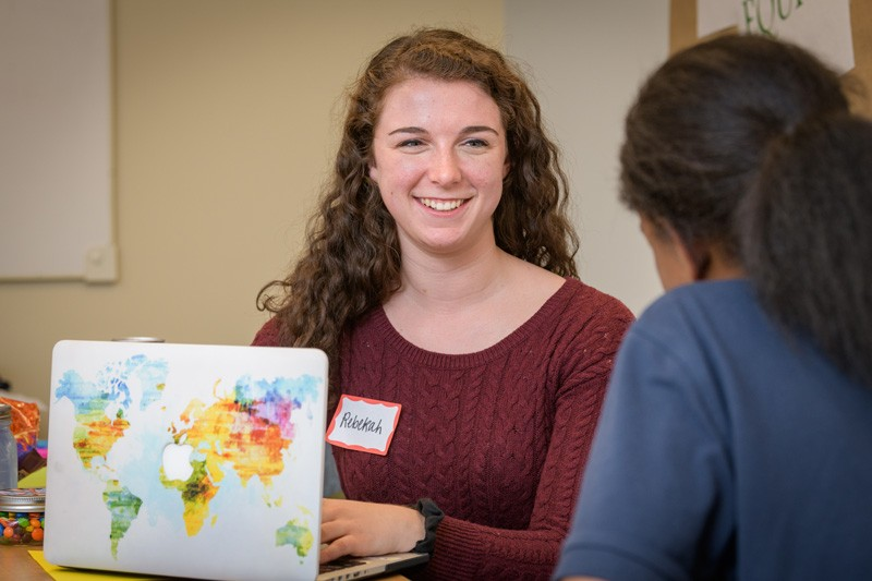 UD senior Rebekah Schrier speaks with a high school student enrolled in the School Offense Diversion Program at the Delaware Center for Justice