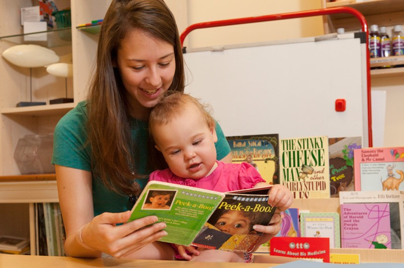 A mother and child enjoy reading together at the University of Delaware