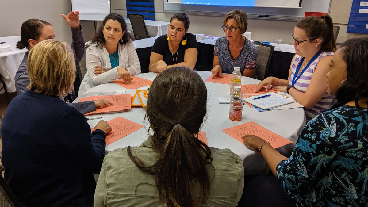 Round table of teachers having a discussion during the Bookworms Institute first session