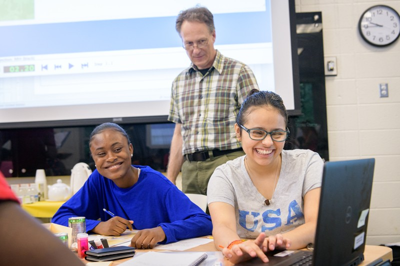 UD Associate Professor Charles Hohensee (center) oversees a summer math workshop for local high school students as part of a $750,000 National Science Foundation grant to study backward transfer