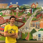 Matt Terranova poses in front of mural at The Early Learning Center
