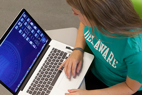 University of Delaware student on a laptop