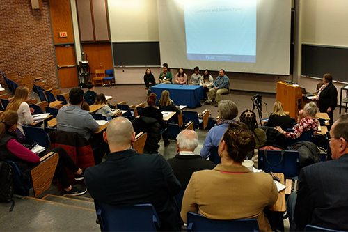 Students speak on a panel at a graduate open house at Willard Hall