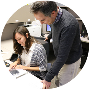 Faculty member works with graduate student