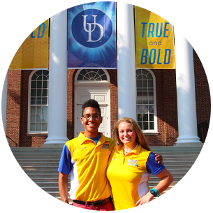 Two new student orientation leaders standing in front of Memorial Hall