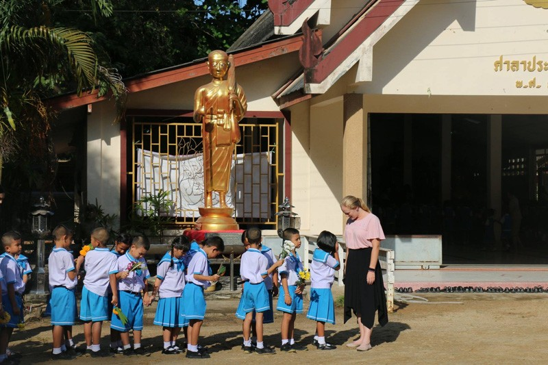 Allison Scott stands with her fourth grade students outside the Surat Thani International School in Thailand.