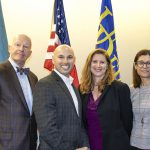 Dean Gary Henry, Laura Desimone, and Chrystalla Mouza posing with Mangone Scholar award winner Joshua Wilson