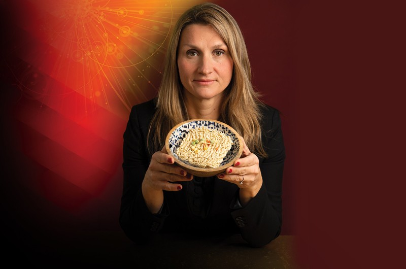 Allison Karpyn holds a bowl of ramen
