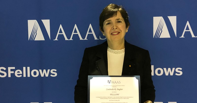 Zoubeida R. Dagher accepts certificate from the American Association for the Advancement of Science for her distinguished contributions to improving kindergarten-through-12th grade science education.