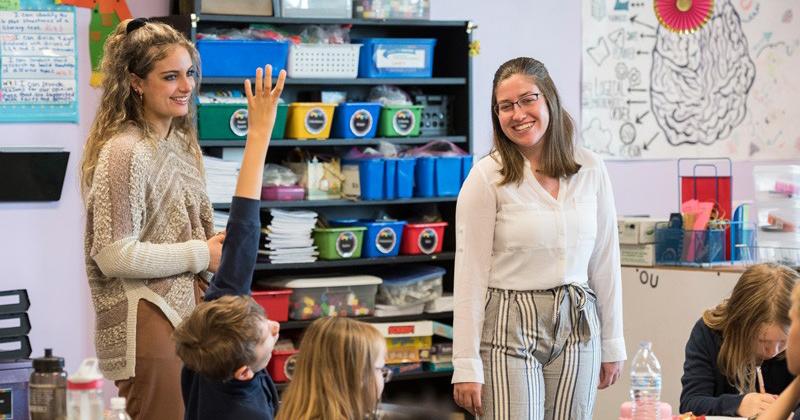 UD elementary teacher education majors Ashley Sullivan (left) and Briana Nolin student-teaching at Providence Creek Academy.