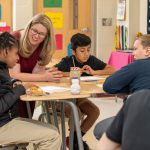 University of Delaware School of Education Professor Amanda Jansen speaks with students at Milford Central Academy