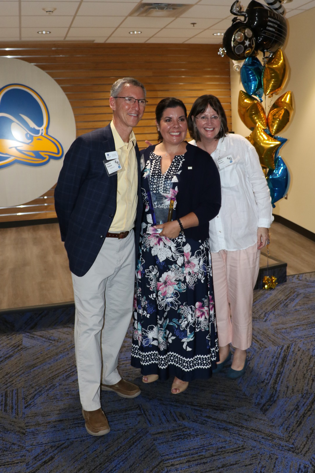 Andrew Walpole and Sharon Walpole pose with award winner Cary Riches