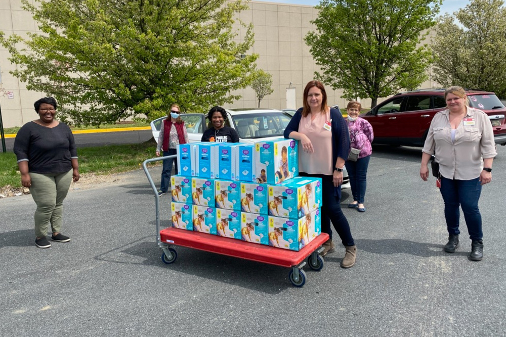 New Directions Early Head Start staff delivering diapers