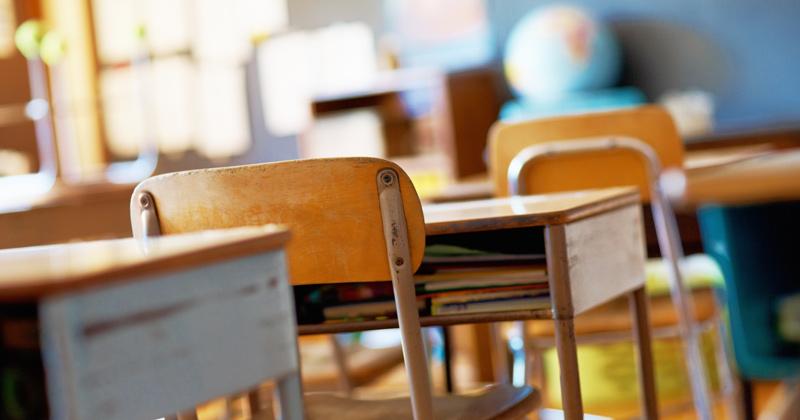 Desk in school classroom