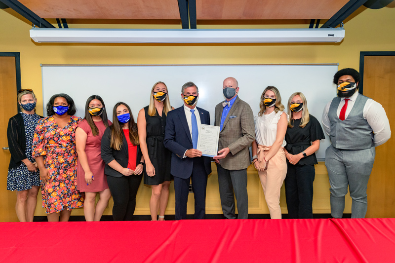 From left to right: Krissy Najera (director of DCTE), Jamie Bailey (director of UD's Teacher Residency program), Mariela Lomeli, Alexa Cruz, Meghan Purcell (UD residents), Governor John Carney, CEHD dean Gary T. Henry, Meghan Salter, Claire Bennett, and Clark Scott (UD residents)